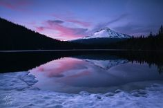Volcanic Twilight by Alex Noriega | Earth Shots    Oregon's Mount Hood and a starry twilight sky reflected in Trillium Lake.