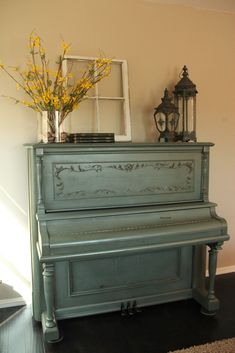 In my rustic dining room, I will have my China hutch and piano both antiqued with blue tents just like this...