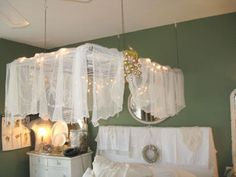 An old window used as a base for a canopy over the bed!