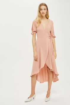 Add a dose of femininity to your look with this crepe dress in nude. In a wrap design, it comes with a v-neckline and pretty tie sleeve detail. Take the look from day to night by adding a subtle low heel.