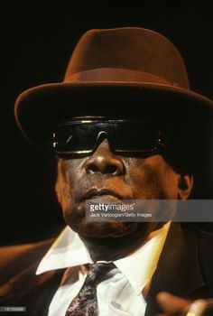 American Blues musician John Lee Hooker (1917 - 2001) performs on the Petrillo Music Shell Stage at the 7th Annual Chicago Blues Festival, Grant Park, Chicago, Illinois, June 10, 1990.