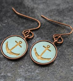 The anchor design is laser engraved into handpainted wood discs, set into round bronze bezels and fitted with matching bronze ear hooks.