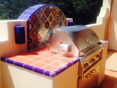 Awesome outdoor bbq with Mexican tile