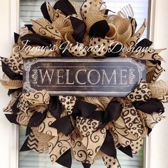 "Burlap ""Welcome"" Wreath with Polka Dot, Swirly, and Leopard Print Ribbons. One in stock.   Jayne's Wreath Designs on fb and Instagram."