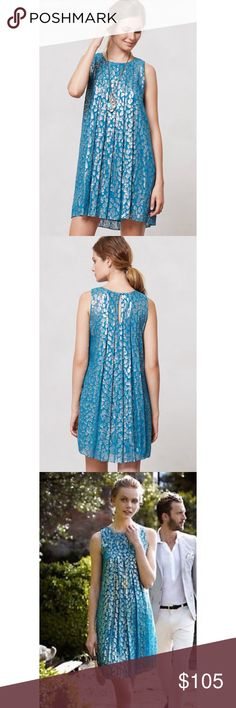 "Anthropologie Shimmer Spot Dress Gorgeous blue dress with silver leopard ""spots"" The blue is so vibrant. Perfect dress for spring or summer! Only worn a few times and in great condition. Size 4. Beautiful pleats, pullover style. Anthropologie Dresses Mini"