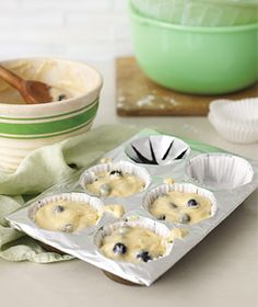 """Shield a muffin tin from burned-on batter drips by laying a foil sheet across it, snipping an X over each cup, then popping in liners. - One of 101 """"new uses for things in the kitchen"""" from Real Simple."""