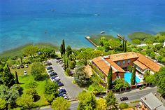 Hotel La Paul - Sirmione ... Garda Lake, Lago di Garda, Gardasee, Lake Garda, Lac de Garde, Gardameer, Gardasøen, Jezioro Garda, Gardské Jezero, אגם גארדה, Озеро Гарда ... Welcome to Hotel La Paul Sirmione. Hotel La Paül is situated few steps from the historical centre and 3,5 km from the highway of Sirmione; the hotels feature their own closed parking, park, equipped beach, landing bridge, bojes, swimming pool, beach bar and playground for children. F