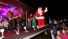 Santa Claus danced on stage and waved at the kids who came to see him at the annual Canadian Pacific Santa Train in Port Haney on Tuesday evening. Tuesday, Stage, Santa, Train, Times, Strollers