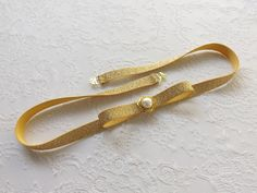 Gold glitter elastic bow belt. Sparkly waist belt. Skinny dress belt. by MissLaceAccessories on Etsy