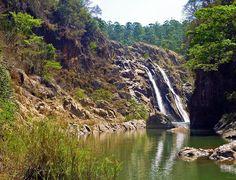 Mantenga Falls, Manzini, Swaziland. Mantenga Falls (95 m high) consists of two parallel streams sliding down along the granite cliff.