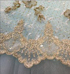 Detail from an aqua and gold tutu plate from tutu.com