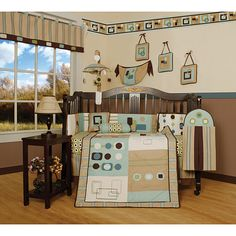 Dress up and decorate your baby's room with this beautiful 13-piece artist crib bedding set. This set includes a crib quilt, two valances, skirt, sheet, bumpers, diaper stacker, toy bag, two throw pillows and three wall hangings.