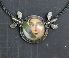 Love Eyes (sterling silver, crystal quartz, paper collage) Dave and Roberta Williamson