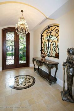 This Custom Mediterranean Residence offers a triumphant blend of Old World Elegance and New World Design. Dream Home Design, Home Interior Design, Interior Architecture, Door Design, House Design, Foyer Flooring, Wrought Iron Decor, House Entrance, Elegant Homes