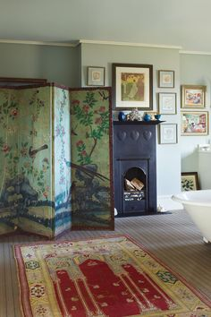 """[i]A cluster of artworks and a chinoiserie screen decorate the main bathroom, which is painted in [link url=""""http://www.farrow-ball.com/""""]Farrow & Ball[/link]'s 'Light Blue'.[/i]  Like this? Then you'll love  [link url=""""http://www.houseandgarden.co.uk/interiors/bathroom""""]Bathroom ideas[/link]"""