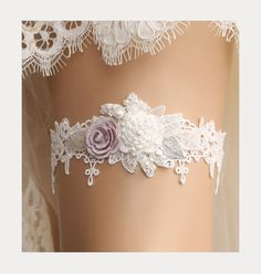 Romantic garter handmade with off white Venice lace, hand beaded white flower and dusty violet flower with silver leaf and crystal beads and pearls.