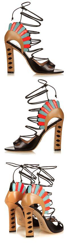 Paula Cademartori's black leather Lotus sandals