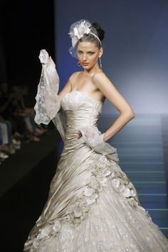 Ian Stuart - Milan Catwalk - 'weddingvine'  Love the fabrics and the silk dupion with the underskirt of the lace tuelle. Love the element of costume design through the collection .