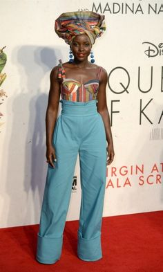"Lupita Nyong'o was ""Queening"" in an ensemble by Rosie Assoulin with a matching head wrap during the premiere of Queen of Katwe in London."