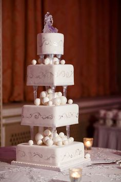 4 tiers wedding cake on columns Winter decor - white, silver and pearl