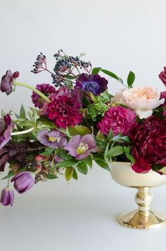 Romantic berry-inspired florals in a classic gold pedestal bowl. | by Gavita Flora