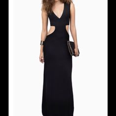 SHOW STOPPER MAXI DRESS! NEW! Black maxi dress. Rayon and spandex. Length is 56 inches slit length is 29 inches. Brand new, never worn, Tobi Dresses Maxi