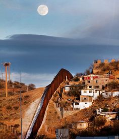 A fence that divides Nogales, Arizona, on the left, from Nogales, Mexico.