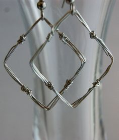wire earrings.  could easily make a barbed wire version from this!