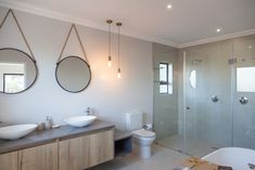 Clean and simple design open plan layout with functional spaces,natural wood textures add warmth. Designer home in Langebaan Country Estate. Country Style Bathrooms, Modern Country Style, Grey Interior Design, Bathroom Interior Design, Timber Vanity, Cupboard Ideas, Frameless Shower, Metal Mirror, White Paneling