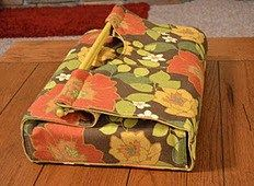 Jolen from Love Of Sewing shows how to make a casserole carrier. The fabric carrier wraps around a 9×12baking dish, with wooden handles for easy carrying. You could make one to give as a Ch…
