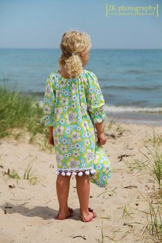 Girl in pretty flowered dress and hat at the beach. #beachgirl