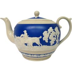 Vintage Spode Copeland Teapot is decorated with a Hunt Scene complete with hounds. The teapot has a dark blue background with white raised figures i