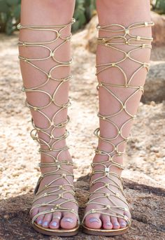 Embody a Greek goddess in these Goddess Gladiator Sandals in gold! Featuring a faux leather material with adjustable, gold glitter elastic straps that crisscross on the front of the leg for a customiz