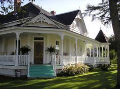 wrap around porches on old farm houses~My dream to have one and turn into an assisted living for elderly. Have plenty of land surrounding for gardening veggies and flowers. Get rescued animals from shelters for companionship. Plenty of rocking chairs for the porch. Meals together on big table in dinning room. Giving family and friendship to those without. Just need to hit lottery. Old Farm Houses, Old Country Houses, Farmhouse Style, Southern Farmhouse, Southern Style, White Farmhouse, Farmhouse Plans, Fresh Farmhouse, Southern Charm