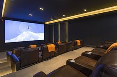 Downstairs is an indoor movie theater with deluxe seating.