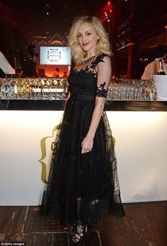 Mixing it up: Fearne later changed into a vintage black lace gown and killer heels as she returned to host the event for the ninth consecutive year