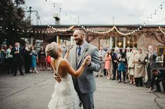 Love that this industrial wedding took the party outdoors with string lights for the dance floor