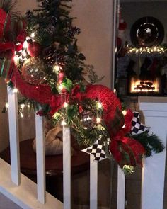 This stunning Christmas staircase garland is decorated with luxury ribbons, velvet poinsettias, and beautiful ornaments in red, green, gold and black and white checkerboard print inspired by MacKenzie Childs. Christmas Staircase Decor, Christmas Bathroom Decor, Diy Christmas Lights, Wooden Christmas Trees, Outdoor Christmas Decorations, Christmas Home, Christmas Wreaths, Christmas Ornaments, Holiday Decor