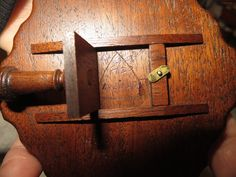 unknown artist - scalloped edge tilt top table - underside of table (also shows maker's mark)
