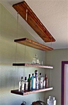 Distressed hardwood and stainless cable suspended liquor shelf ‹ San Diego Cable Railings