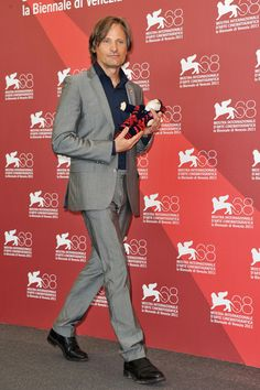 Holding a knitted puppet in San Lorenzo colours (Venice Film Festival, 2011)