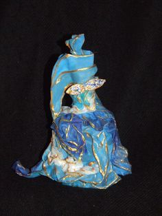 Customized perfume bottle, transformed into a character made of silk hand-painted unique piece, a Harlequin's Carnival of Venice. Art Nouveau period.