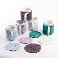 The perfect gift for your tea lover.   Mug with a handmade jacket with button fastenings with a matching coaster.