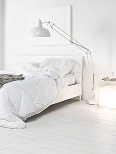 all white bedroom, large industrial floor lamp.