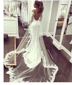 I like the veil type train on this dress! Would love to find something like this for mine!❤