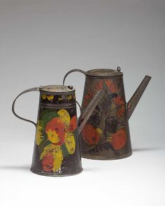 TWO AMERICAN PAINTED TINWARE COFFEE POTS WITH FLORAL MOTIFS.