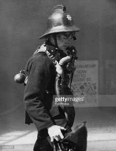 News Photo : A fireman with breathing apparatus leaving...