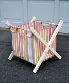 DIY fold-up fabric hamper tutorial. Use snaps instead of buttons.