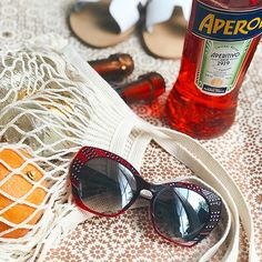 Parisian girl apéro essentials 🕶🍹Taking my sunnies game up a notch in this red pair with hand encrusted bling from @lafontparis #lafont  .  .  .  .   #citylove #dcitystyle #igdc #igdcfamily #mydccool #dc #dclife #dclifestyle #dcstyle #acreativedc #bythings #liveauthentic #dailyinspiration #goodvibes #homesweethome #summer #summerthings   #sunnies #summerstyle #sunglasses #eyewear #vacationmode #aperolspritz #aperolspritz