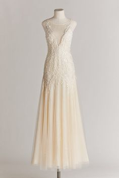 Chic, Sophisticated Wedding Dresses for Romantics: The Stunning Josina gown marries contemporary design with vintage Hollywood glamour. Layers of ivory tulle form a twirl-perfect skirt, while stunning beading, a deep-v of lace in back, and a dipped illusion neckline add an elegant edge.